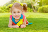 Cute little girl in park — Stock Photo