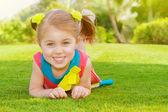 Cute little girl in park — Stock Photo