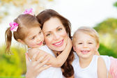 Mother with two kids — Stock Photo