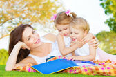 Mother with two kids outdoors — Stock Photo