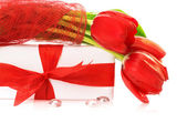 Red tulips with gift box — Stock Photo