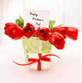 Red tulips with white giftbox — Stock Photo
