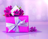 Pink gift box with greeting card — Stock Photo