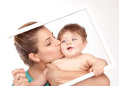 Mother kiss little son — Stock Photo
