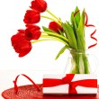 Red tulips and present box — Stock Photo