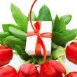Red tulips with gift — Stock Photo #21647789