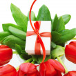 Red tulips with gift — Stock Photo