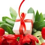 Red tulips and white gift box — Stock Photo