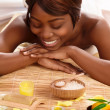 African woman on massage table — Stock Photo