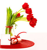 Red tulips bouquet with gift — Stock Photo