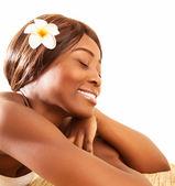 African woman in spa salon — Stock Photo