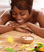 African woman on massage table — Stok fotoğraf