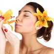 Girl enjoy lily flower smell — Stock Photo
