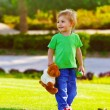 Little boy in spring park - Stock Photo