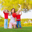Happy family in spring park — Stock Photo #22007705