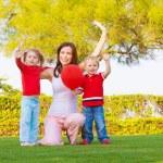 Happy family in spring park — Stock Photo