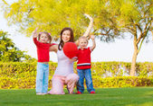 Happy family in spring park — Stock Photo