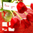 Red tulips with postcard - Stockfoto