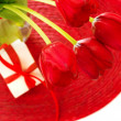 Red tulips and gift box - Stockfoto