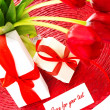 Red tulips and two gift box — Stock Photo