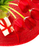 Red tulips and gift box — Stock Photo