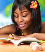 African woman on the beach — Stock Photo