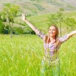 Female enjoying green field — Stock Photo
