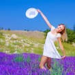 Cute girl dancing on lavender field - Foto Stock