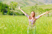 Female enjoying green field — Stock Photo