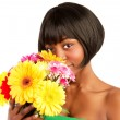 Black woman with flowers - Stock Photo