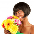African woman with spring flowers — Stock Photo