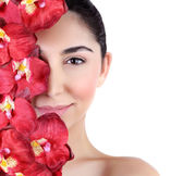 Woman with orchid flowers on face — Stock Photo