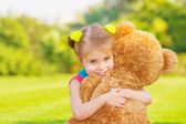 Happy girl with soft toy — Stock Photo