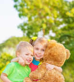 Happy children on backyard — Stock Photo