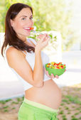 Pregnant girl having breakfast — Stock Photo