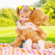 Stock Photo: Happy girl with teddy bear