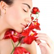 Arabic woman with red orchid — Stock Photo
