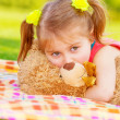 Cute child with teddy bear — Stock Photo