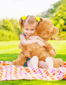 Happy girl with teddy bear — Stok fotoğraf