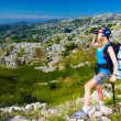 Female in mountains look in binocular - Stok fotoğraf