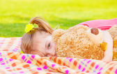 Little girl with soft toy — Stock Photo