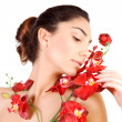 Cute female with red orchid — Stock Photo