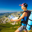 Active girl with map in the mountains — Stock Photo