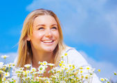 Cute female on daisy meadow — Stock Photo