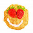 Pancake with smiley face - Stock Photo