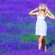 Cute girl enjoy lavender meadow — Stock Photo