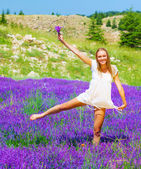 Nice woman dancing on lavender field — Stock Photo