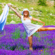 Female dance on lavender meadow — Stock Photo