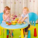 Happy kids paint Easter eggs — Stock Photo