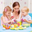 Mother with kids paint Easter eggs — Stock Photo